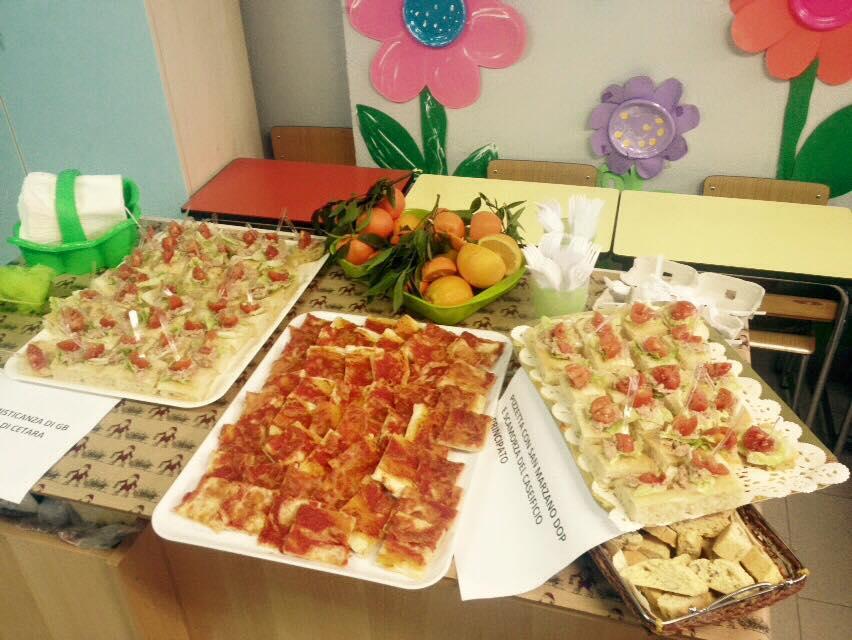Misticanza di Gb Agricola e pizza con San Marzano e scamorza, preparate da Rinaldo Ippolito